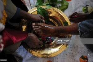 DENVER, CO - APRIL 1: Deacon Buruk Kidane (R) has his feet and hands washed by Reverend Gebrekiros at the Ethiopian Orthodox Church April 1, 2010 in Denver, Colorado. Members of the Ethiopian Orthodox Church celebrated Holy Thursday by prayer and the traditional washing of the feet and hands by Reverend Gebrekiros. (Photo by Matt McClain/Getty Images)