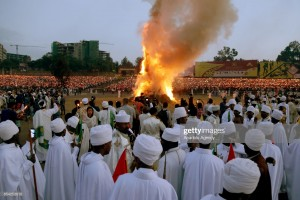 ADDIS ABABA, ETHIOPIA - SEPTEMBER 26 : Ethiopian Christians gather around a huge fire during the Meskel Festival, commemorating the discovery of the True Cross by the Roman Empress Helena (Saint Helena) in the fourth century, at Meskel Square in Addis Ababa, Ethiopia on September 26, 2017. Thousands of Christian Orthodoxes gathered with their traditional white clothes. (Photo by Minasse Wondimu Hailu/Anadolu Agency/Getty Images)